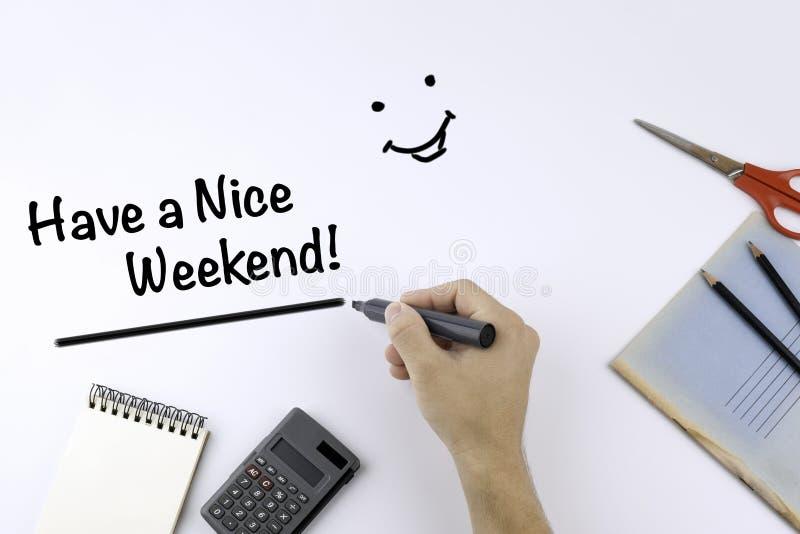 Ręka z markiera writing - Ładnego weekend! zdjęcie stock