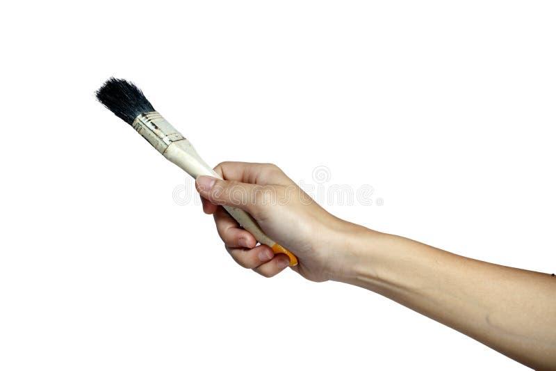 Ręka z muśnięciem obrazy stock