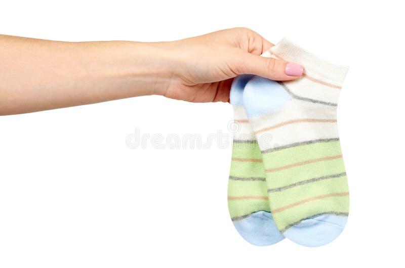 Ręka z pasiastą bawełnianą skarpetą, dziecka obuwie fotografia royalty free