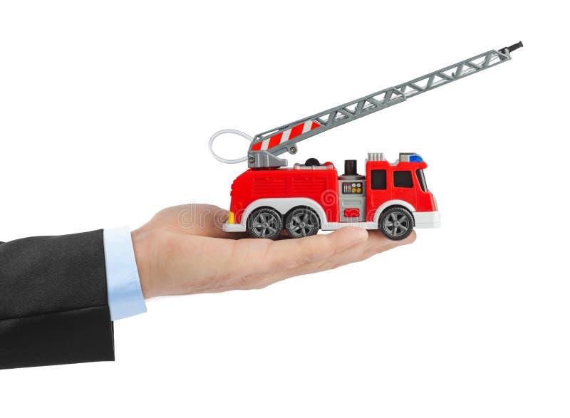 Ręka z samochodem strażackim obraz royalty free