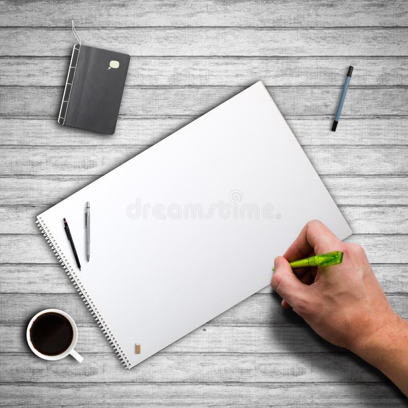 Ręka zaczyna pisać na pustej kanwie fotografia stock
