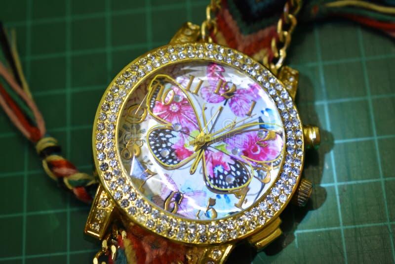 Ręka zegarka motyl fotografia stock