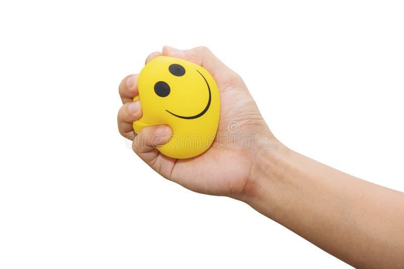 Ręki ściśnięcia stresu żółta piłka, odizolowywająca na białym tle, złości zarządzanie, pozytywni myślący pojęcia zdjęcia royalty free