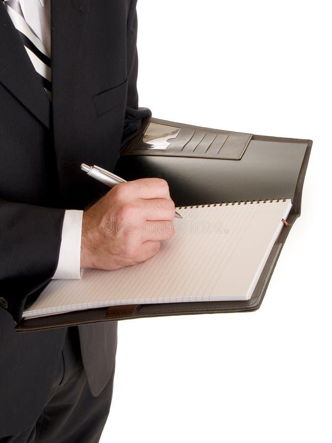 Ręki - biznesmen bierze notatki obraz stock