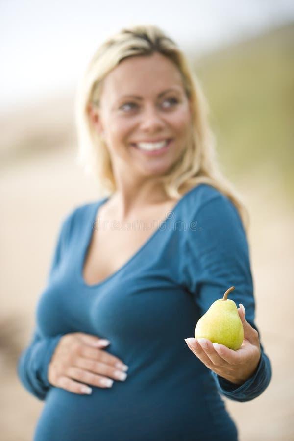 ręki bonkrety ciężarna uśmiechnięta kobieta obraz royalty free
