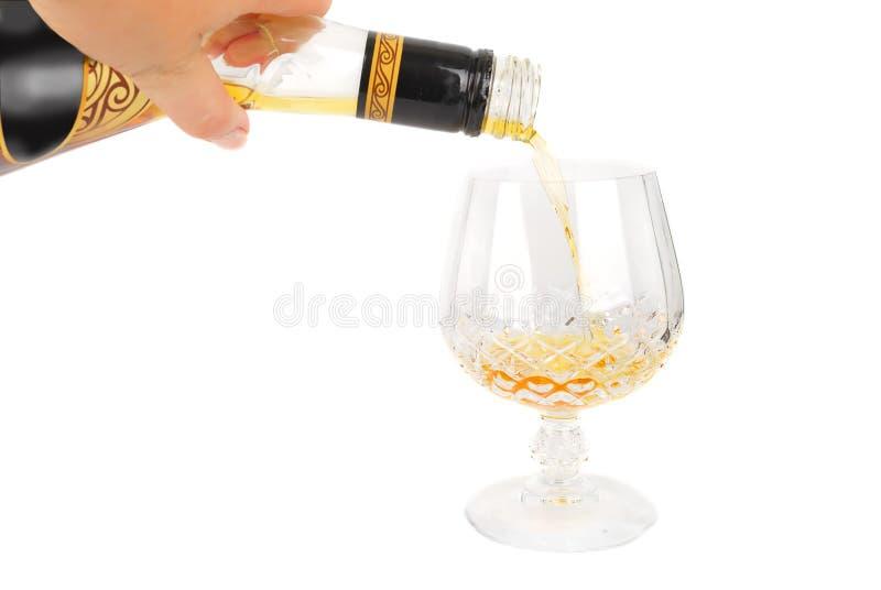 ręki butelki brandy obrazy stock