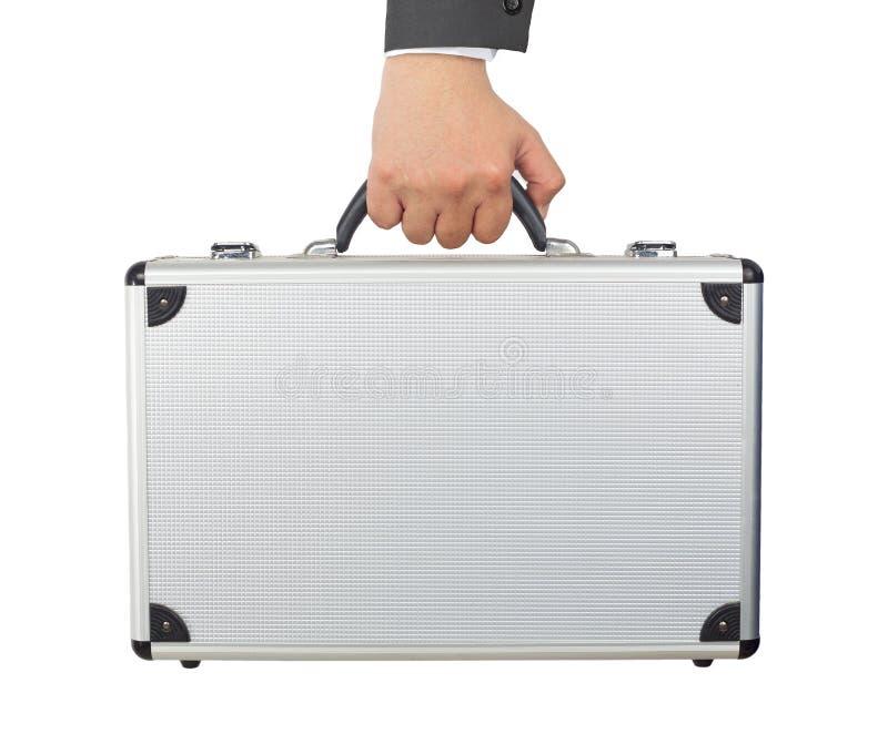 Ręki i ręki mienie osrebrza bagaż lub krótką skrzynkę odizolowywających na wh zdjęcia stock