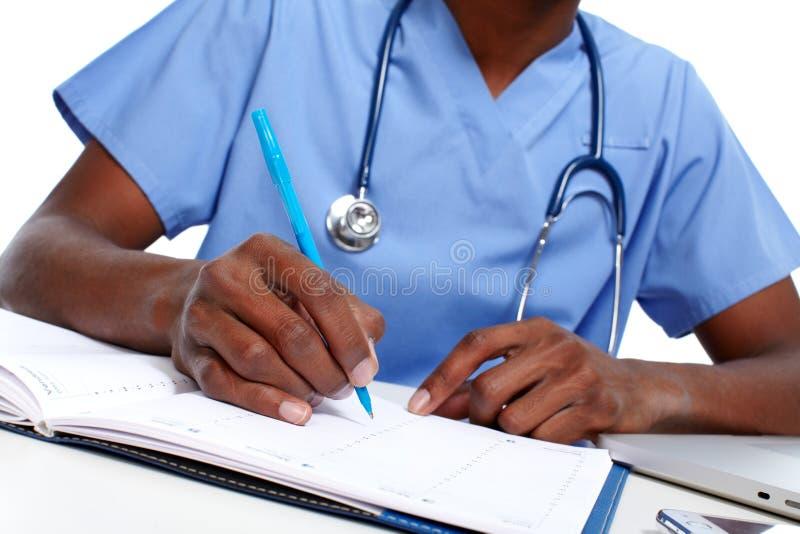 Ręki lekarza medycyny writing recepta fotografia royalty free