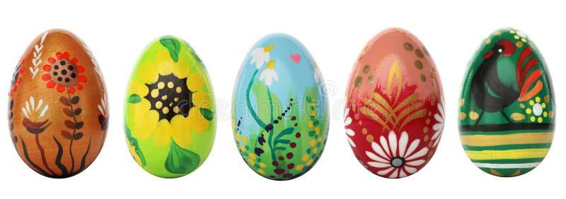 Ręki malujący Wielkanocni jajka odizolowywający na bielu Wiosna wzory zdjęcia stock