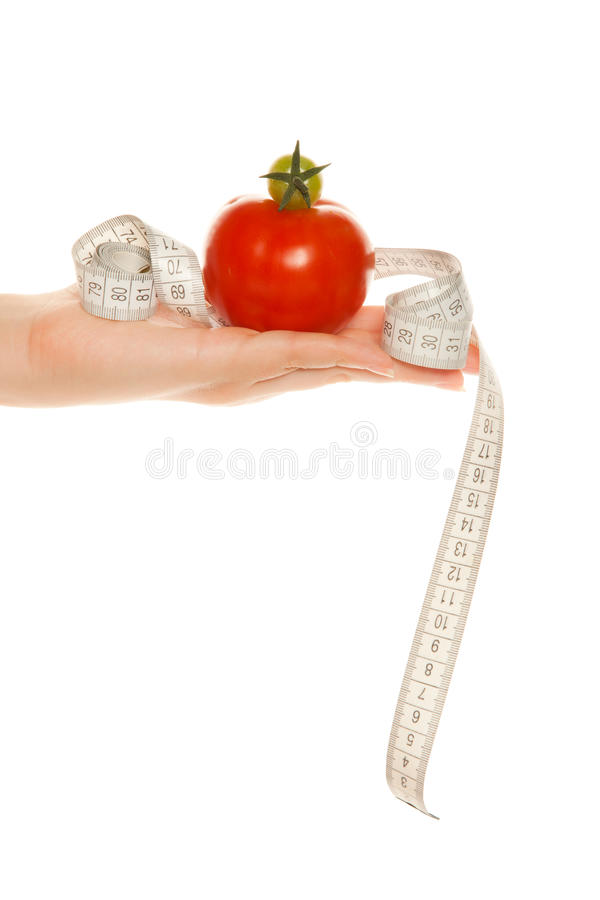 ręki miara s taśmy pomidorów kobiety obraz stock