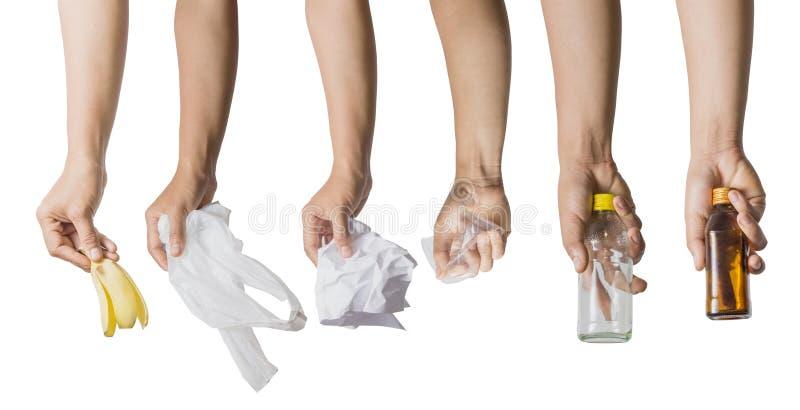 Ręki mienia bananowa łupa odizolowywająca na białym tle obrazy stock