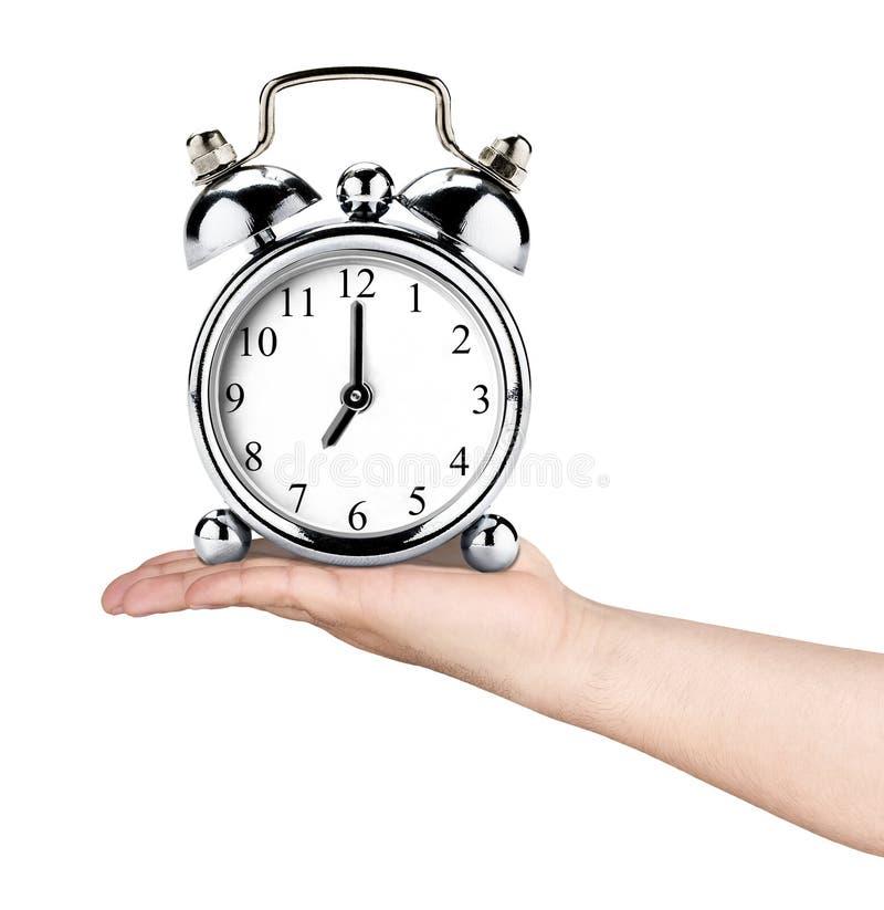 Ręki mienia rocznika zegaru Retro alarm Odizolowywający fotografia royalty free