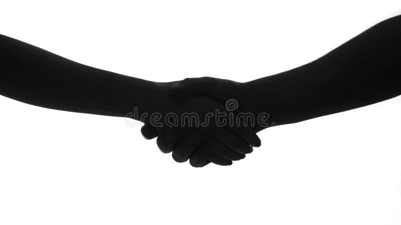 Ręki potrząśnięcia mężczyzna kobiety sylwetka zdjęcie royalty free