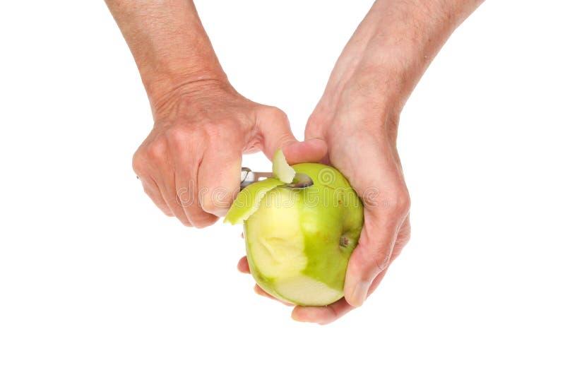 Ręki struga jabłka zdjęcia royalty free