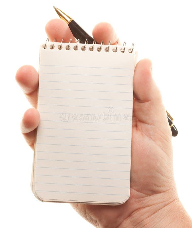 ręki target1257_1_ męskiego ochraniacza papieru pióro zdjęcie royalty free