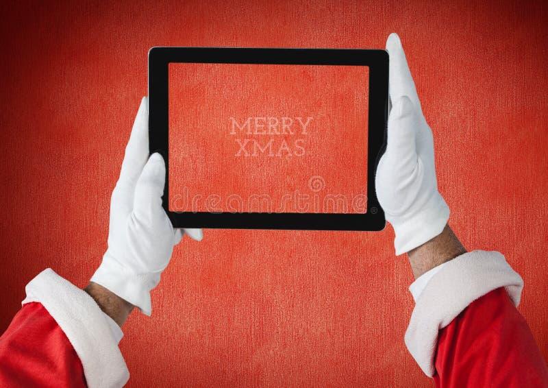 Ręki trzyma cyfrową pastylkę Santa Claus zdjęcie stock