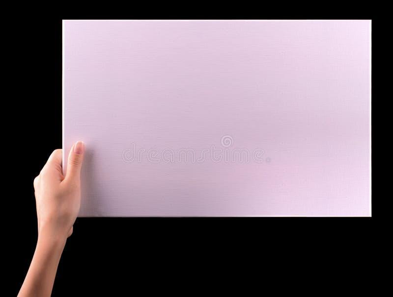 Ręki trzyma dużego pustego papieru sztandar zdjęcie royalty free