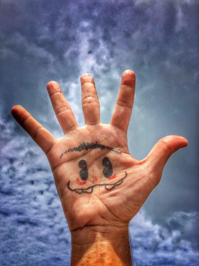 Ręki twarz zdjęcia stock