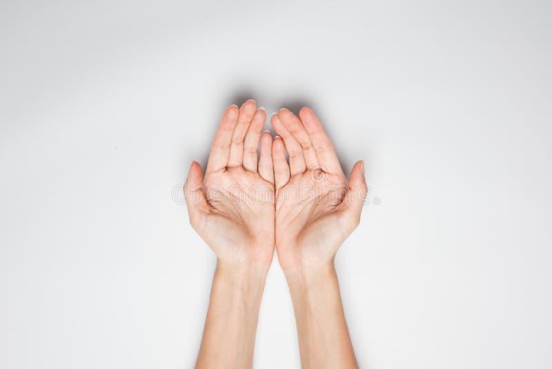 Ręki w mienie pozyci obraz stock