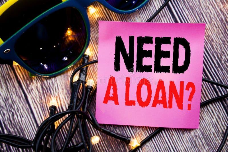 Ręki writing teksta podpisu seansu potrzeba Pożyczkowy pytanie Biznesowy pojęcie dla Hipotecznego kredyta pisać kleistej notatki  zdjęcia stock