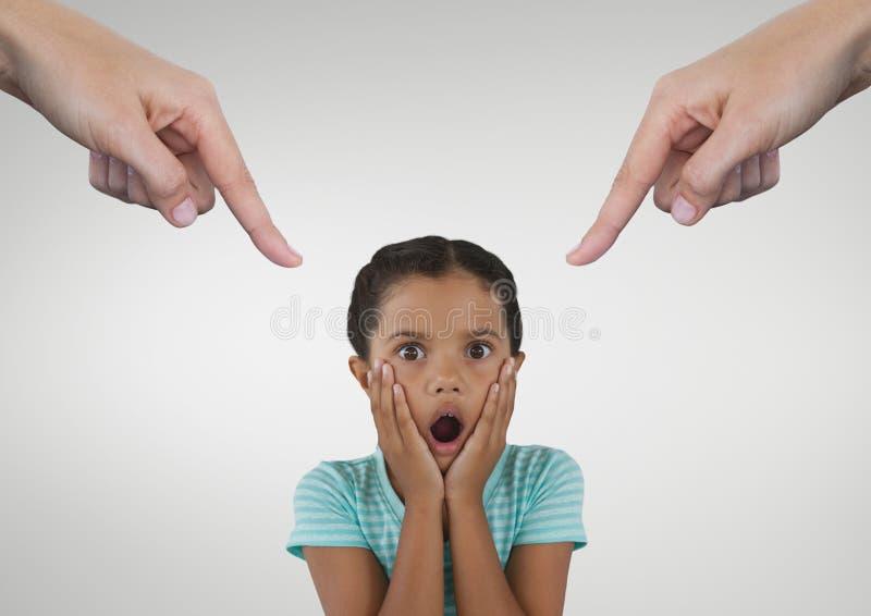 Ręki wskazuje przy zdziwioną dziewczyną przeciw białemu tłu obraz royalty free