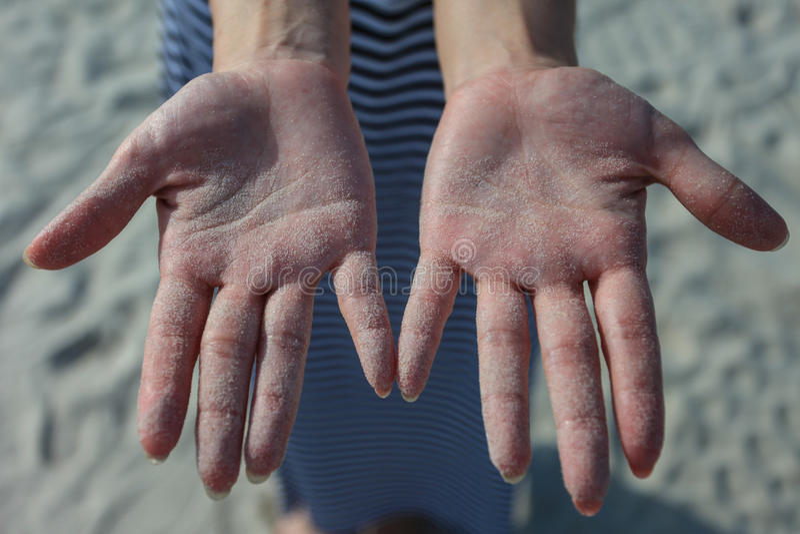 Ręki z piaskami fotografia royalty free