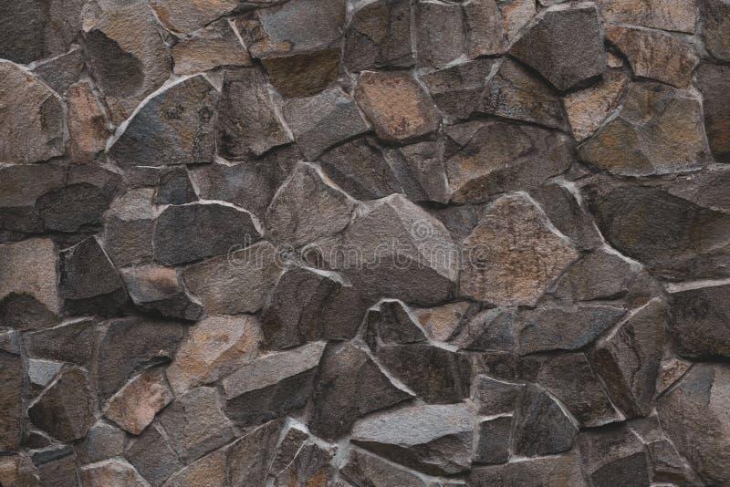 r Предпосылка каменной стены Брауна, текстура утеса Предпосылка дизайна Конкретная поверхность m Кафельное backgrou стоковые изображения