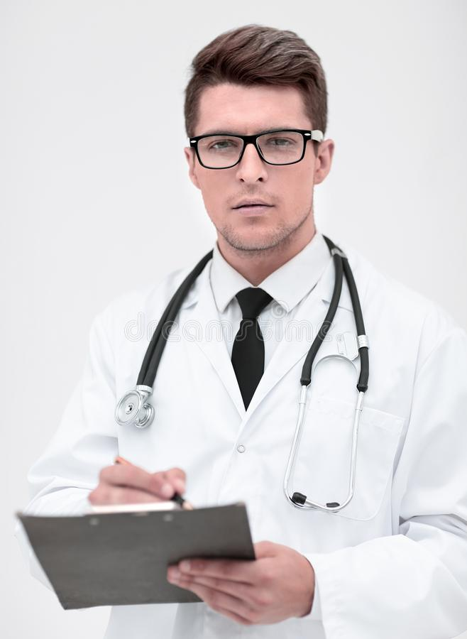 r терапевт с доской сзажимом для бумаги стоковая фотография rf