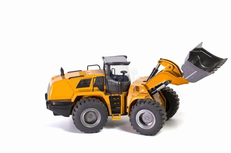 R/C模型拖拉机赛车看法在白色背景的 时间儿童和成人概念 免版税库存照片