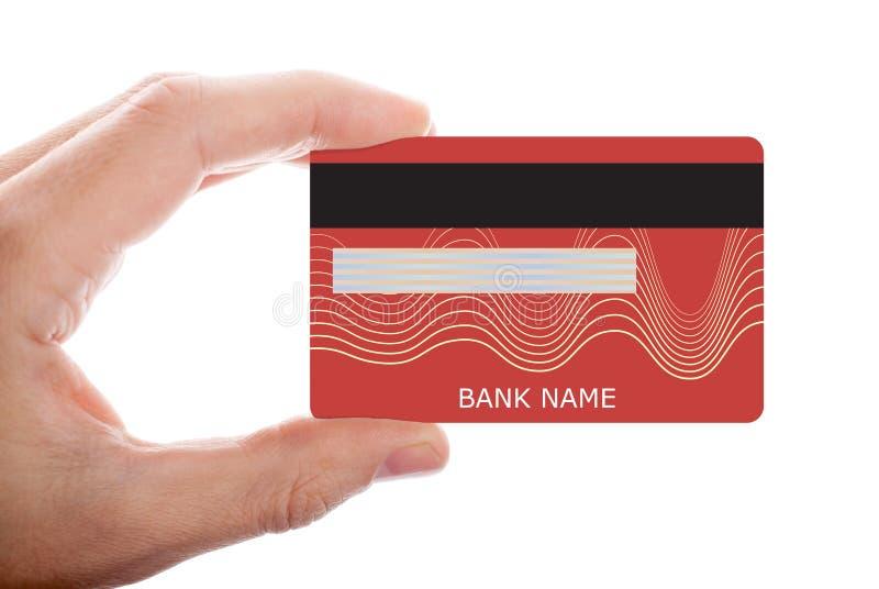R?d kreditkort f?r handinnehav som isoleras p? vit bakgrund royaltyfri foto