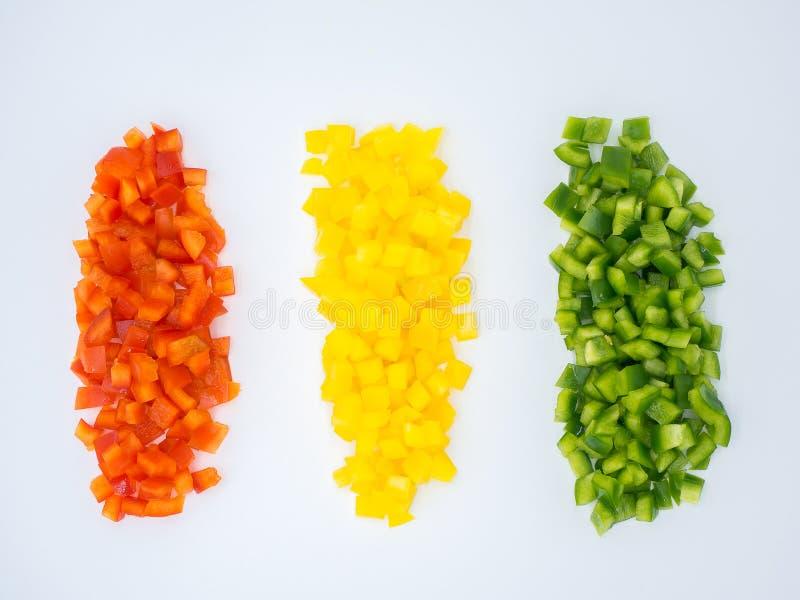 R?da, gr?na och gula s?ta spanska peppar royaltyfri foto