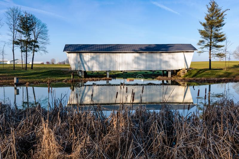 R.F. Baker Covered Bridge reflected. Rushville, Ohio/USA-January 5, 2019: Historic R.F. Baker Covered Bridge, originally built in 1871 over Little Rush Creek at stock photography