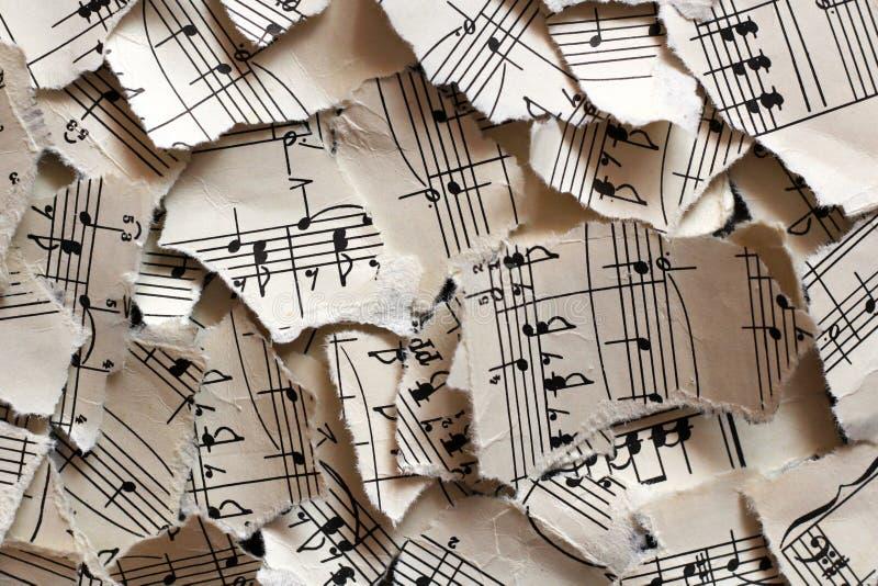 r Izhevsk, Russie Notes musicales d?chir?es, morceaux de papier pour le fond photographie stock libre de droits