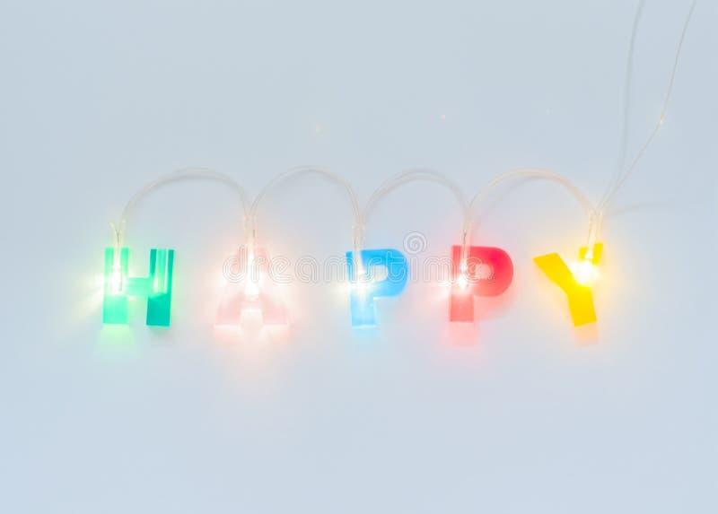 r Multicolored gloeiende brieven op witte steenachtergrond Het geleide volumetrische van letters voorzien stock foto's