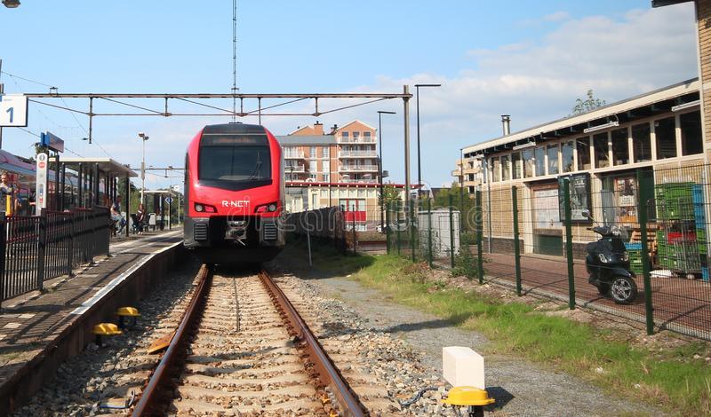 R-Net light rail type flirt in red and black at Boskoop station for trains beween Gouda and Alphen aan den Rijn royalty free stock photo