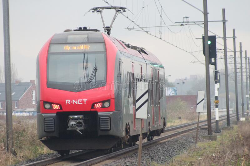 R-Net light rail type flirt in red and black at Waddinxveen for trains beween Gouda and Alphen aan den Rijn in the Netherlands. royalty free stock images