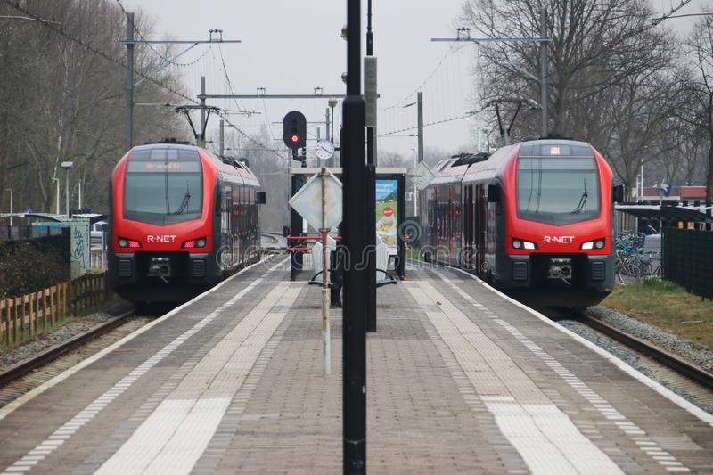 R-Net light rail type flirt in red and black at Waddinxveen for trains beween Gouda and Alphen aan den Rijn in the Netherlands. stock images