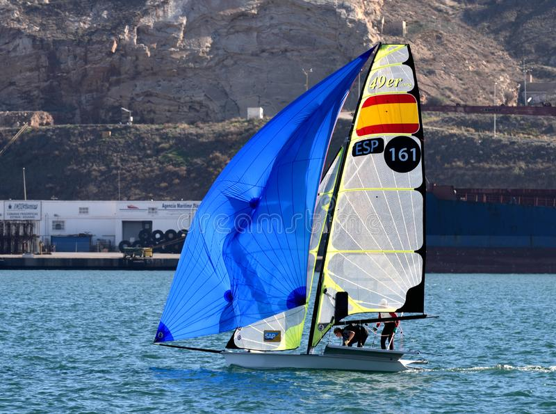 49r skiff dinghy. The 49er, a two-handed skiff-type high-performance sailing dinghy in training in the waters of the port of Cartagena. The moment of starting stock photo