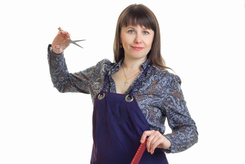 R stylista z nożycami w ręce i fartuchu obrazy royalty free