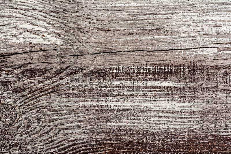 R?tros le fond et la texture criqu?s et superficiels par les agents de style de cru en bois noir gris de mur photo stock