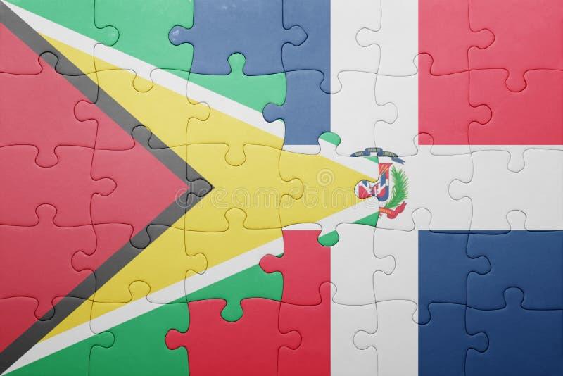Raadsel met de nationale vlag van Dominicaanse republiek en Guyana stock foto's
