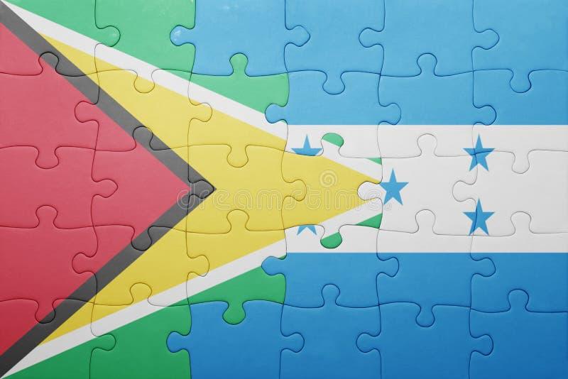 Raadsel met de nationale vlag van Honduras en Guyana royalty-vrije stock fotografie