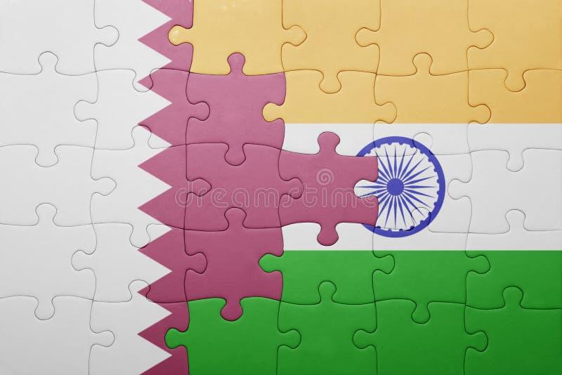 Raadsel met de nationale vlag van India en Qatar stock fotografie