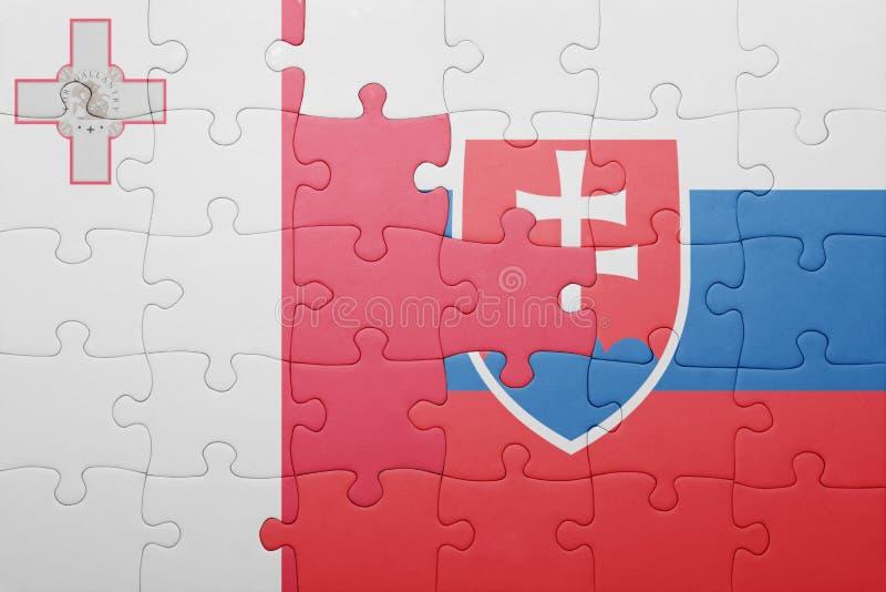 raadsel met de nationale vlag van Slowakije en Malta stock foto