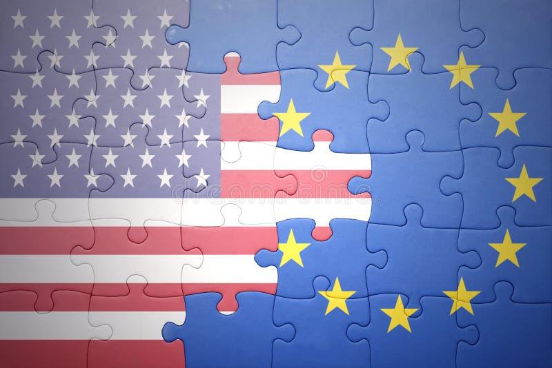 Raadsel met de nationale vlaggen van de Europese Unie van de Verenigde Staten van Amerika en stock afbeeldingen