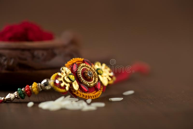 Indian festival: Raksha Bandhan.A traditional Indian wristband which is a symbol of love between Brothers and Sisters. royalty free stock photos