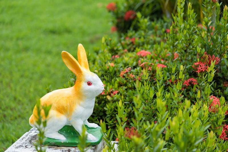 Rabbit doll in the garden. Rabbit doll in the garden royalty free stock images