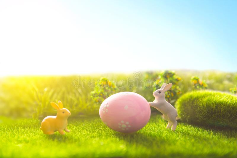 Rabbit and easter eggs in green grass with blue sky. Rabbit and easter eggs in a green grass with blue sky stock image