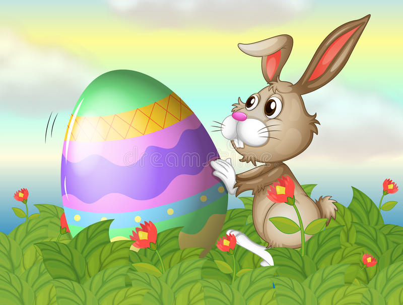 A rabbit and a large egg in the garden royalty free illustration