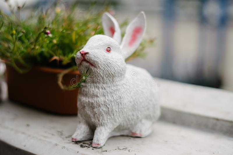 Rabbit statue with plant pot.  royalty free stock images